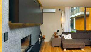 Dom jednorodzinny z elewacją z klinkieru i płyt prodema. Zobacz wnętrza z dwustronnym kominkiem